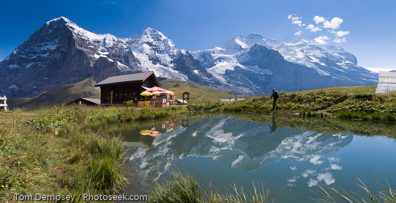 Eiger, Monch and Jungfrau (Ogre, Monk and Virgin) reflect in a pond at Kleine Scheidegg train station, in the Berner Oberland.